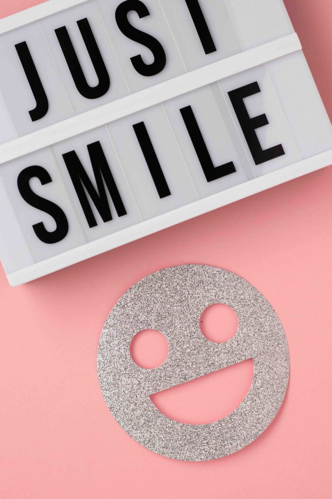 Just smile marquee with smiley face
